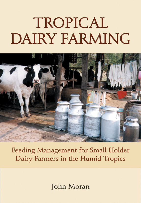 The cover image of Tropical Dairy Farming, featuring white and black cows