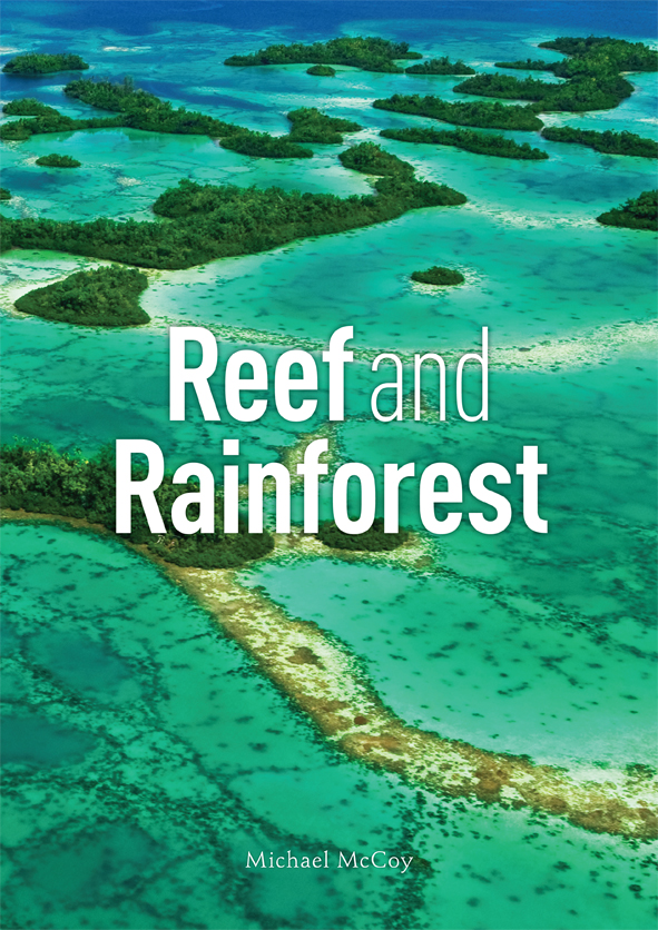 The cover image of Reef and Rainforest, features an arial view of clear br