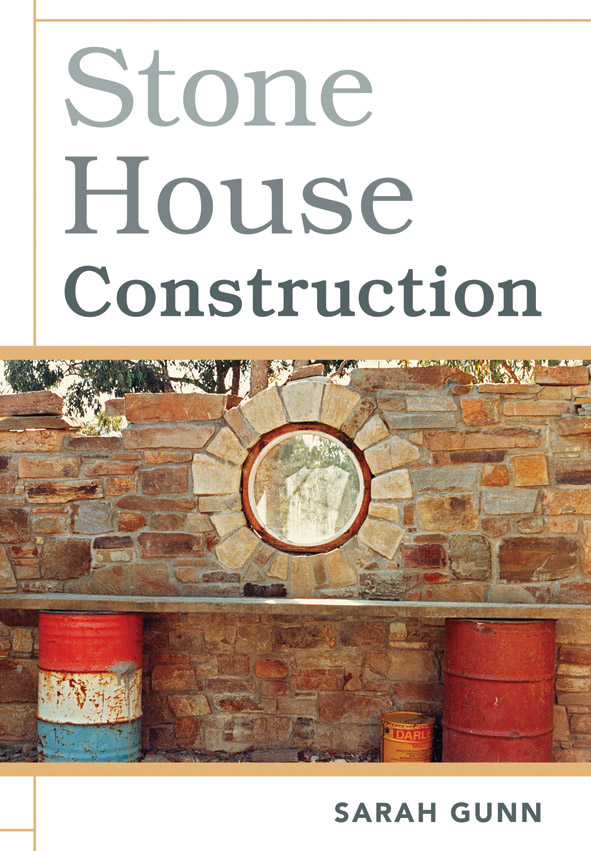 The cover image of Stone House Construction, featuring a stone wall with a