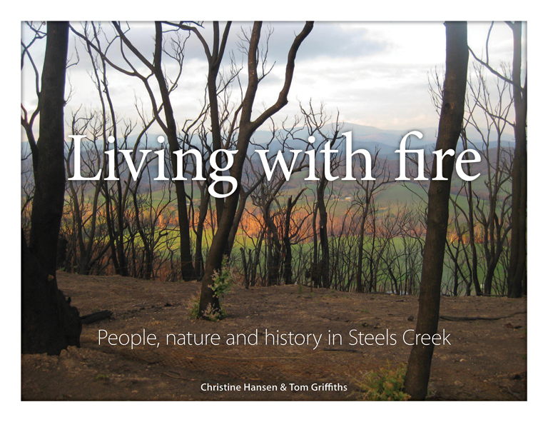 The cover image of Living with Fire, features multiple tree trunks which h