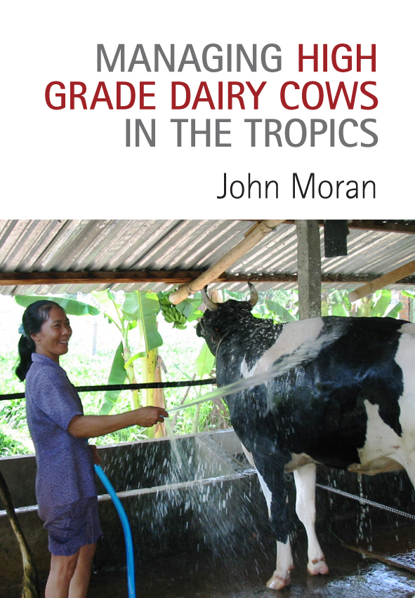The cover features a smiling south east asian woman hosing a large black a