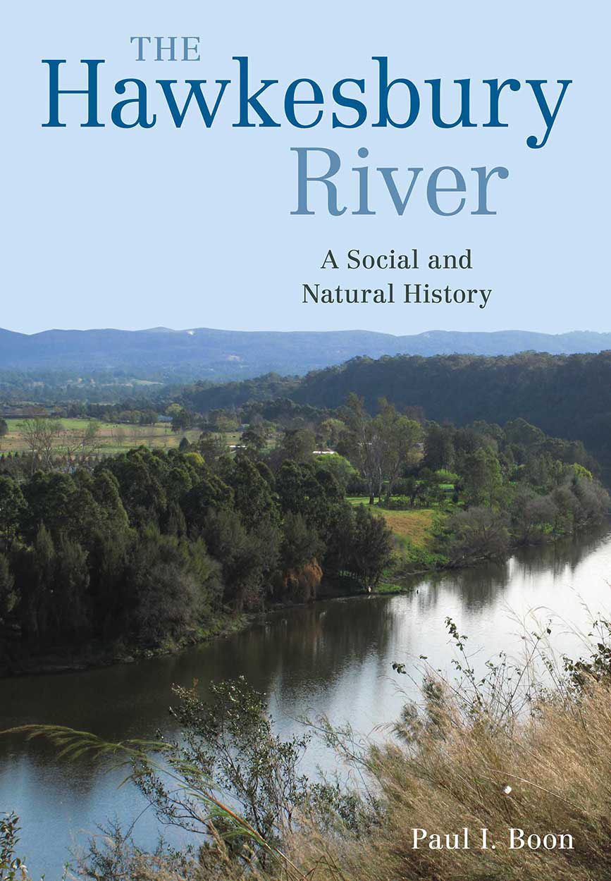 Cover image with a photo of a sweeping river view from a raised river bed