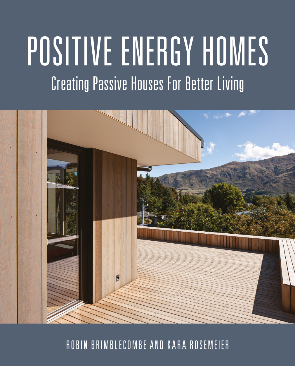 Cover of featuring exterior photograph of wooden home with mountains in ba