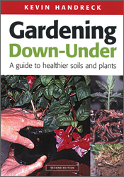 The cover image of Gardening Down-Under, featuring a persons hands holding