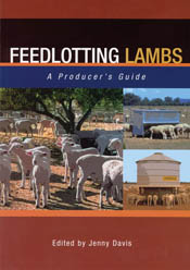 The cover image of Feedlotting Lambs, featuring lambs standing on red eart