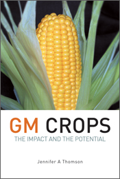 The cover image of GM Crops, featuring a large cob of yellow corn, surroun