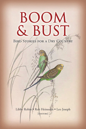 The cover image of Boom and Bust, featuring two budgerigars holding on to