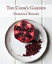 Cover image of The Cook's Garden, features half a sliced open pomegranate