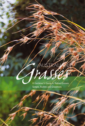 Cover features close up dry brown grass against blurry green background.