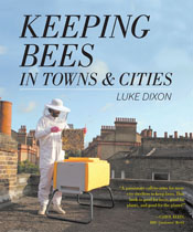 Cover image is a person in a bee keeping suit next to a hive on a roof.