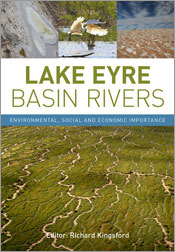 Cover featuring a large aerial photo of river beds running through a green