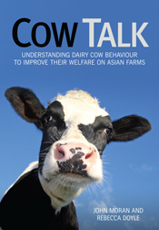 Cover image of Cow Talk, featuring a close-up photo of a dairy cow on a bl