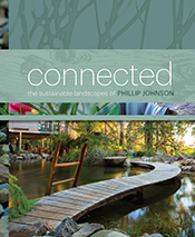 Cover is a photograph of a garden with a board walk stretching across a gr