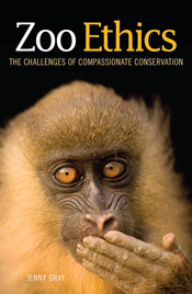Cover featuring a portrait of a mandrill, with its hand over its mouth and