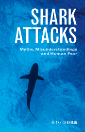 Cover image of Shark Attacks featuring a photo of the silhouette of a shar