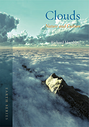 Cover featuring mountain and view of clouds from above.