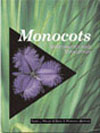 The cover image of Monocots: Systematics and Evolution, featuring a purple